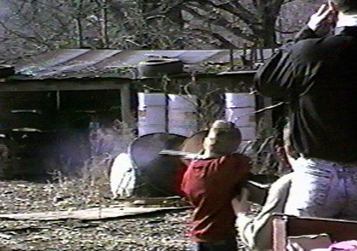 Andrew Golden is shown shooting a rifle at the age of six in this undated image from a home video.