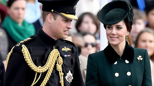 Prince William and Catherine, Duchess of Cambridge, during the Irish Guards St Patrick's Day Parade before heading to Paris. (AFP)