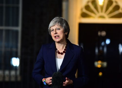 British Prime Minister Theresa May addresses the media after her Cabinet backed the draft Brexit deal.