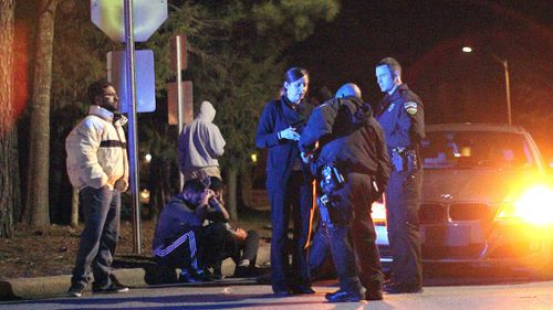 Chapel Hill police officers at the murder scene. (AAP)