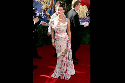 """<b>Where she wore it:</b> The 58th Annual Primetime Emmy Awards, 2006.<br/><br/><b>The look:</b> """"Crap!"""" thought Paula. """"The Emmys are <i>tonight</i> and I haven't got a dress yet! Maybe I could whip something up out of these floral-print curtains in my grandma's house...?"""""""