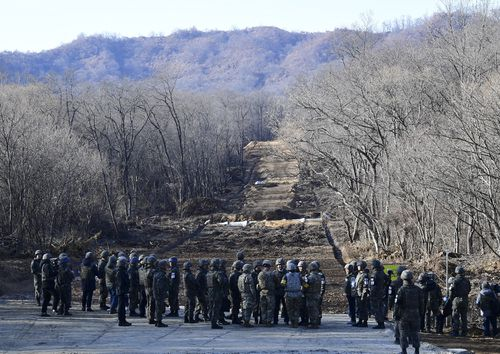 The three kilometre-long tactical road across the Military Demarcation Line inside the Demilitarized Zone (DMZ) will be used to support a joint project to excavate Korean War remains at a notorious battle site.