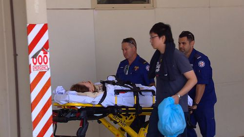 Two people were transferred by ambulance to John Hunter Hospital with spinal injuries. (9NEWS)