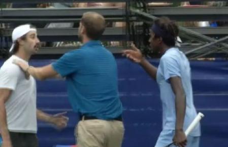 Umpire holds back Aussie after tennis match explodes