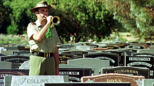 A lone bugler sounds the 'Last Post' at Centennial Park. (AAP)
