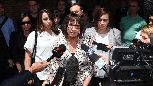 "Jennifer Karmas (centre), the wife of murder victim Elisha ""Sam"" Karmas, speaks to the media, surrounded by family, outside the NSW Supreme Court in Sydney, Thursday, November 8, 2018."