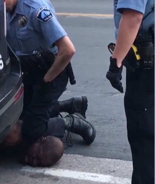 Officers were seen kneeling on the man's neck as he told them 'everything hurts'.