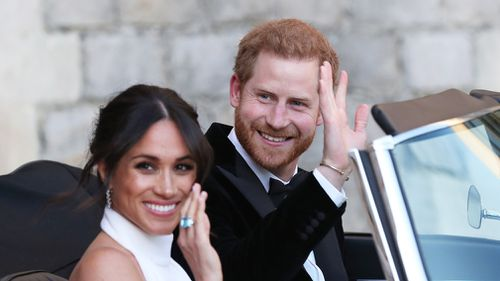 The Duke and Duchess of Sussex, Meghan Markle and Prince Harry, wave goodbye. Picture: PA