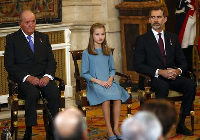 "Spain's former King Juan Carlos, left, Princess Leonor and King Felipe sit during a ceremony in which Princess Leonor was presented with the insignia of the ""Toison de Oro"" in 2018."