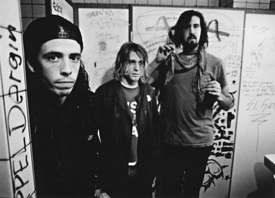 American rock group Nirvana, backstage in Frankfurt, Germany, 12th November 1991. Left to right: drummer Dave Grohl, singer and guitarist Kurt Cobain (1967 - 1994) and bassist Krist Novoselic.