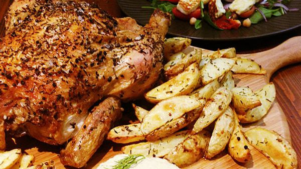Herb-roasted chicken with haloumi salad and hummus