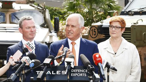 Malcolm Turnbull, flanked by Defence Industry Minister Christopher Pyne and Defence Minister Marise Payne. (AAP)