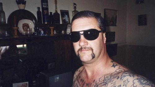 """Mark """"Chopper"""" Read in his Hobart home in January 2001."""