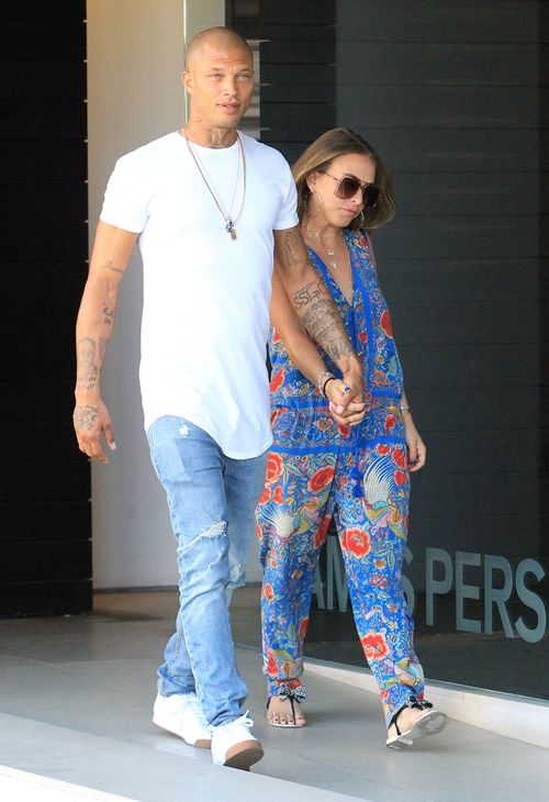 The couple enjoy a stroll in Los Angeles in October around the time Chloe fell pregnant. Picture: AP