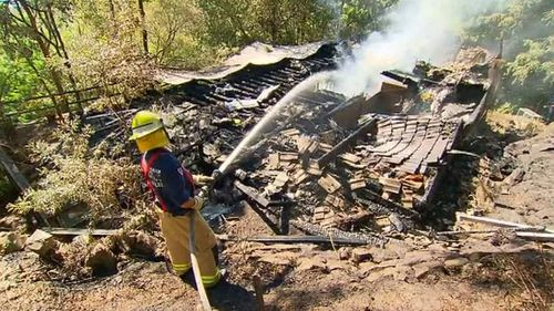 The bodies of two people were pulled from the wreckage of the fire at the Bayview home. They are yet to be identified. (9NEWS)