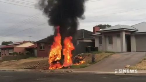 A man was lucky to escape when he lost control of his car, before it flipped and exploded in flames hitting a power pole.