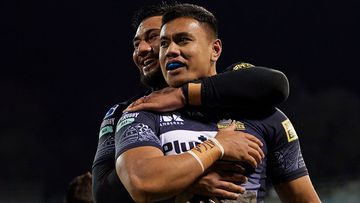 Len Ikitau of the Brumbies celebrates with team mates after scoring a try during the round four Super Rugby Trans-Tasman match between the ACT Brumbies and the Hurricanes at GIO Stadium on June 05, 2021 in Canberra, Australia. (Photo by Brett Hemmings/Getty Images)