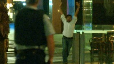 Another male hostage ran from the cafe with his hands in the air. (9NEWS)