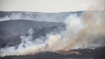 A fire blazes through the Latakia countryside in Syria on September 10, 2020.