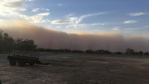 Locals at Dunlop Station near Bourke were treated to amazing views as the dust cloud rolled across the town's skyline.