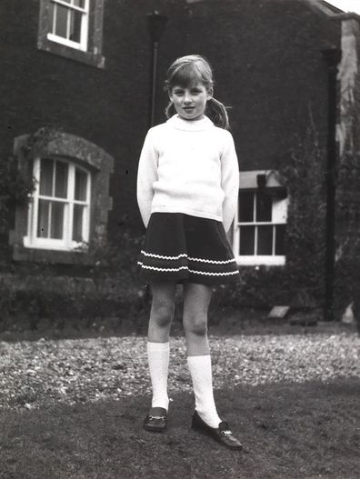Princess Diana stands outside Park House on the Queen's Sandringham Estate in Norfolk, which is where she was born, in a photo taken by her father