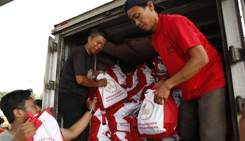 Aid has started to reach the main city of Palu, but people are desperate for help.