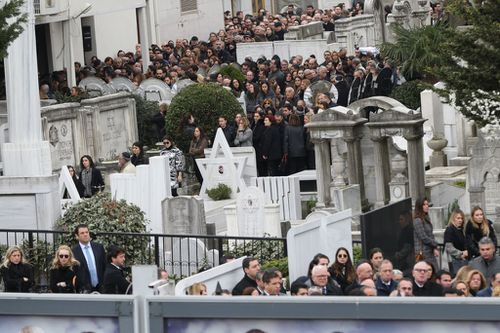 Relatives and friends of Liana Kalma Hananel gather to attend her funeral ceremony at the Ulus Sephardi Jewish Cemetery. (Getty)
