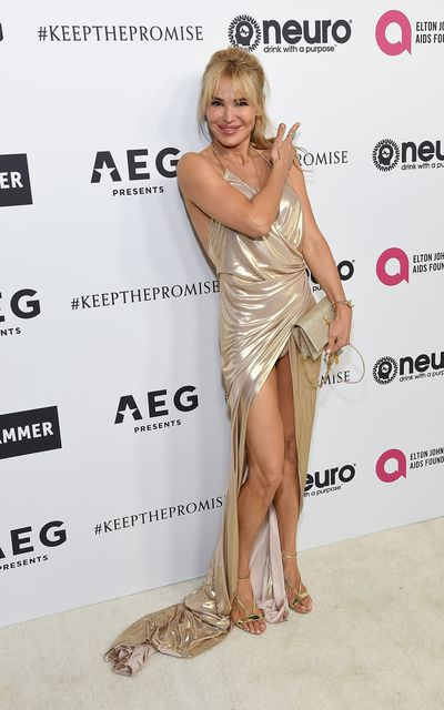 Diana Jenkins gold lame gown had a dangerous split.
