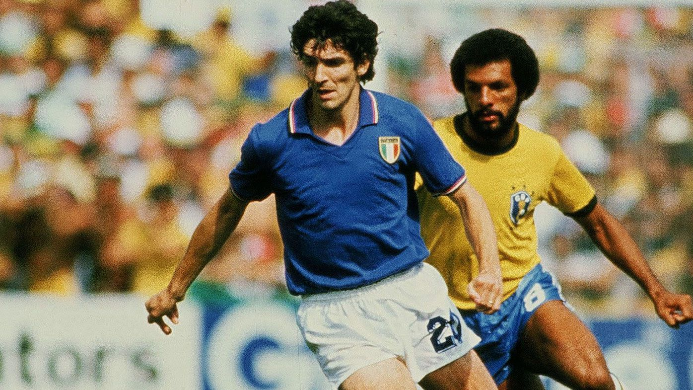 Paolo Rossi of Italy competes for the ball with Leovegildo Lins da Gama Júnior of Brazil during the World Cup Spain 1982 match between Italy and Brazil at Estadio de Sarrià on June 5, 1982 in Barcelona , Spain.