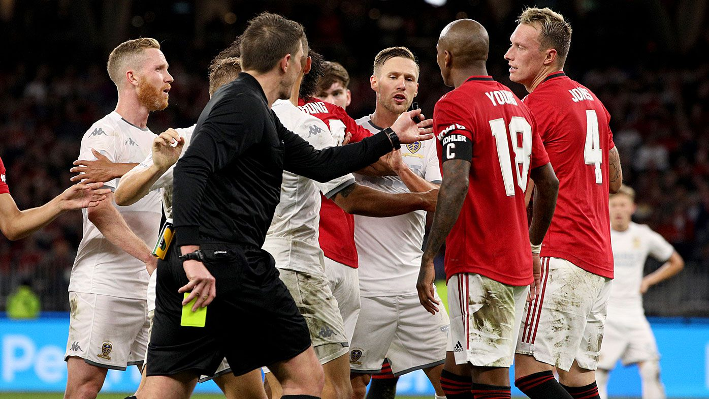 Manchester United and Leeds United players scuffle after a tackle by Ashley Young