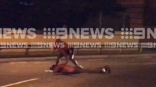The man was pushed on the road and then punched a number of times. (9NEWS)