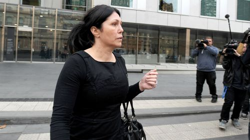 oberta Williams leaves the Victorian County courts after giving evidence in the on-going Coronial Enquiry into the murder of Victorian police informer Terrence Hodson and wife Christine in 2014. (AAP)