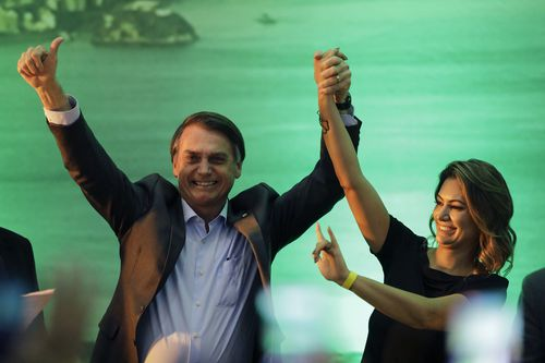 Jair Bolsonaro and wife Michele on the campaign trail.