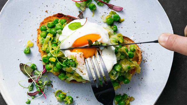 Smashed peas on toast with egg