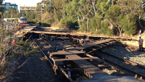 Freight train collision derails carriages and forces road closures in Adelaide