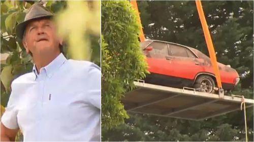 Neil watched on as his Ford was lifted into the air. (9NEWS)