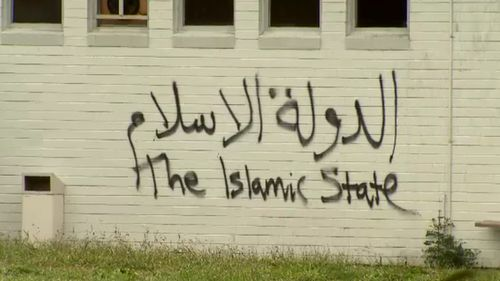 """Islamic State"" graffiti was sprayed on to the side of the building. (9NEWS)"