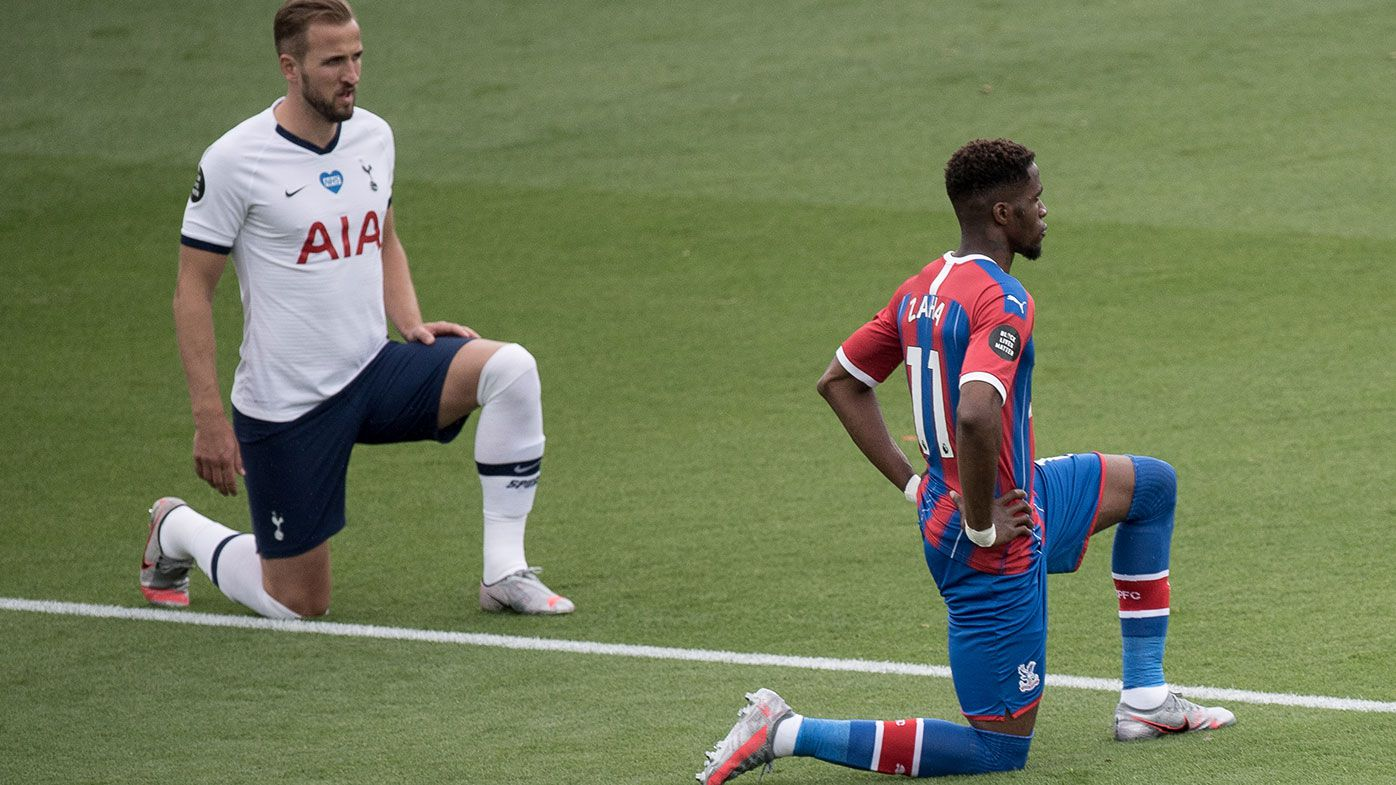 Harry Kane of Tottenham Hotspur and Wilfried Zaha of Crystal Palace take a knee during the Premier League match between Crystal Palace and Tottenham Hotspur