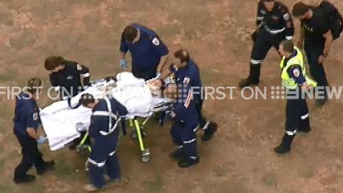 The police officer fell at least 20m. (9NEWS)