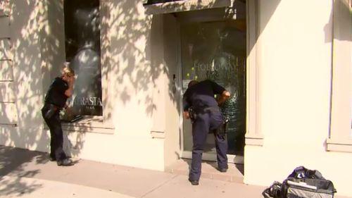 Police scour the scene for evidence. (9NEWS)