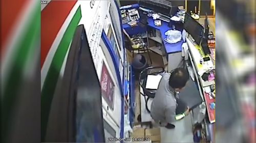 The thief notices the store is empty and first takes the till containing more than $800 (9NEWS)