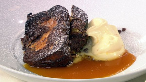 Baked french chocolate and brioche pudding with orange butterscotch toffee and double cream