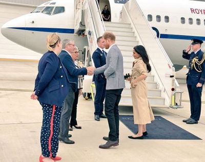 Meghan carries a mobile phone in Melbourne