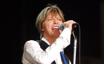 David Bowie, singing on stage
