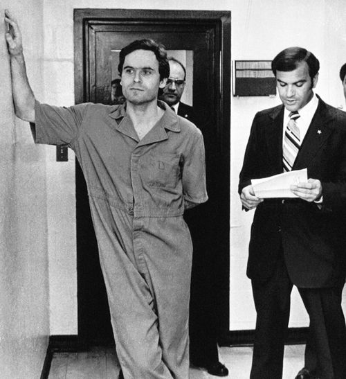 Theodore Bundy makes himself comfortable as Sheriff Ken Katsaris reads the indictment handed down by the Leon County Grand Jury, July 27, 1978 in Tallahassee, Florida.