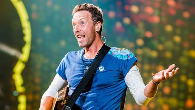 Chris Martin, performing, on stage