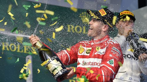 Sebastian Vettel celebrates his 2017 win. (AAP)
