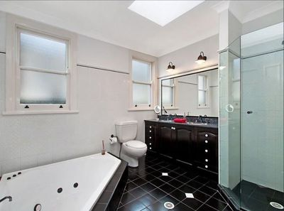 <strong>Before: dated black bathroom</strong>