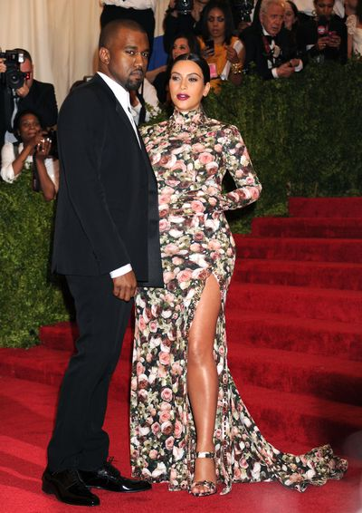 Kim Kardashian in floral Givenchy at the 2013 Met Gala with Kanye West.