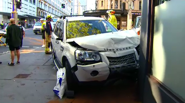 Emergency services were called to the corner of Elizabeth and Goulburn Streets after a crash between a van and a truck where the truck clipped a building.